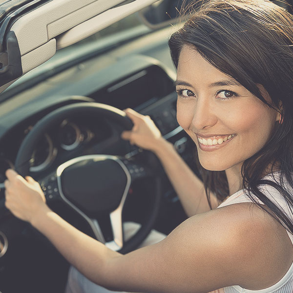 Young-girl-steering-car